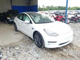 vin: 5YJ3E1EA9MF853784 2021 Tesla Model 3